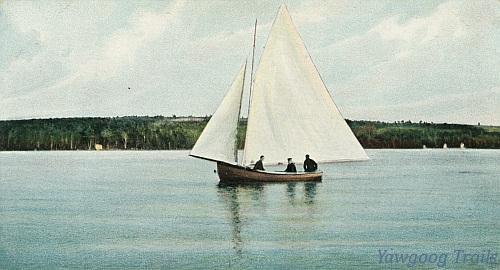 Color lithographed postcard of three men on a sailboat on the pond.