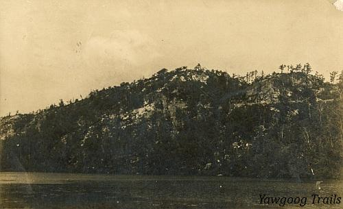 Black and white postcard of Lantern Hill, with a pond in foreground.