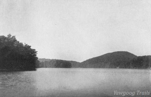 Black and white photograph of pond with Lantern Hill in the distance.